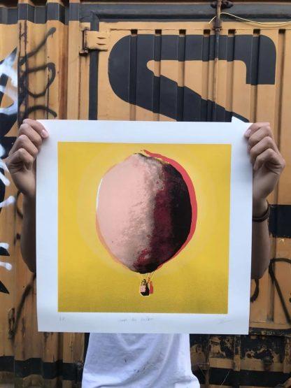 Zé Monteiro holding screen print lemon air balloon